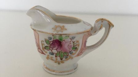 The miniature china milk jug which formed part of the teaset.