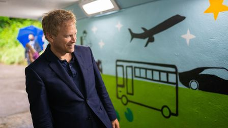 Grant Shapps MP viewing transport artwork in the Hatfield subway
