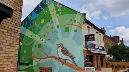 The colourful artwork depicts a nightingale bird in song