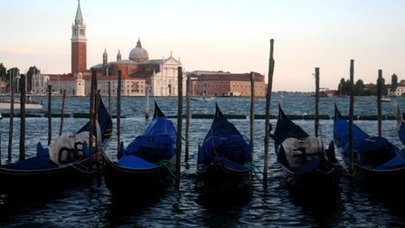 Gondolas in Venice with cathedral visible behind