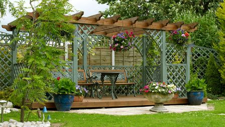Outdoor garden structure built with furniture to relax in outside with Luxury Living Outside in Cheshire.