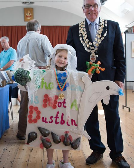 Thomas pictured in his costume with the mayor standing next to him