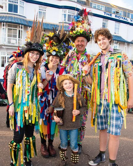 Thomas in the centre with four people dressed in morris dancing outfits
