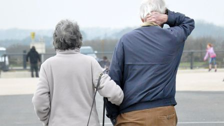 Undated file photo of two pensioners walking. Men are afforded more advantages than women in ageing