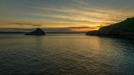 Sunset over Thatchers Rock and Tor Bay, Devon.