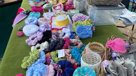 Knitted tea cosies and items at a Devion cafe.