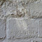 The old St Paul's Cathedral carved into the wall in St Mary's Church, Ashwell