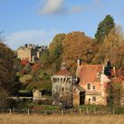 View of the house and old castle ruins in autumn at Scotney Castle, Kent