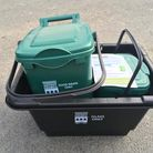 A glass recycling box and a food waste caddy