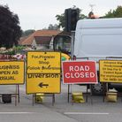 Roadworks which have closed Salhouse Road meaning a long diversion to the Woodside News shop, also k