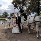 Family poses with horses and carriage