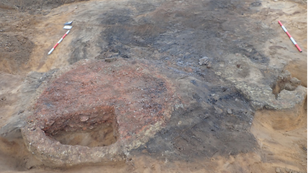 The circular oven (left) and an irregular hearth (right) were uncovered by archaeologists in Fritton, near Gorleston-on-Sea.