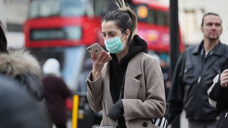 A woman wearing a face mask mask in Oxford Street in London.