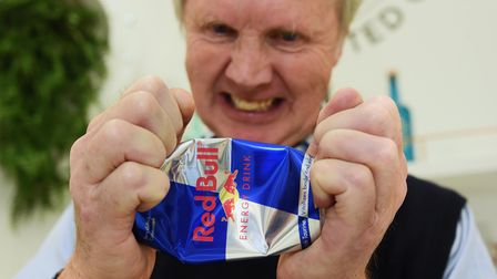 John Bullard crushes a Red Bull can as Red Bull accuses Bullards of a conflict of interest with the
