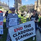 Campaigners demonstrated outside Parliament to call for an end to the cladding crisis