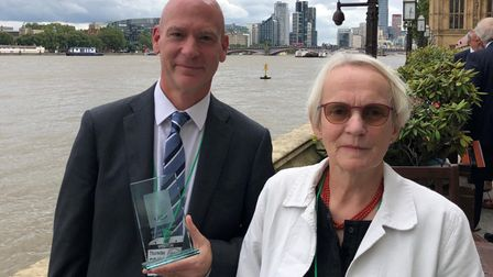 Two people - Jonathan Culpin and Claire Lawton - at the House of Commons, London with an award for Anglian Learning
