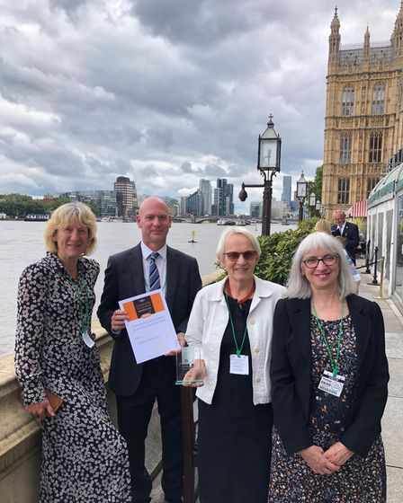 Four people from Anglian Learning collect an award at the House of Commons, London