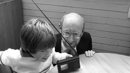 Sir Clive Sinclair, founder and chairman of Sinclair Research, watches 8-year-old Joe Challands