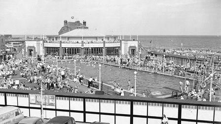 Vintage cars line the car ark outside Gorleston outdoor swimming pool during a busy August heatwave in the 1950s.
