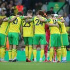 The Norwich players in the pre match huddle before the Carabao Cup Second Round match at Carrow Road