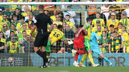 Emmanuel Dennis of Watford scores his sides 1st goal during the Premier League match at Carrow Road,