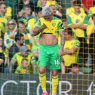 The Norwich players look dejected after conceding their sideÕs 1st goal during the Premier League ma
