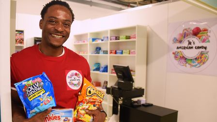 Junior Ngoma at his sweet shop, JR's American Candy, at the Ipswich Microshops. Picture: DENISE BRAD