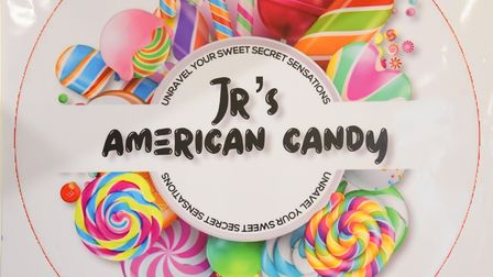 Junior Ngoma's sign at his sweet shop, JR's American Candy, at the Ipswich Microshops. Picture: DENI