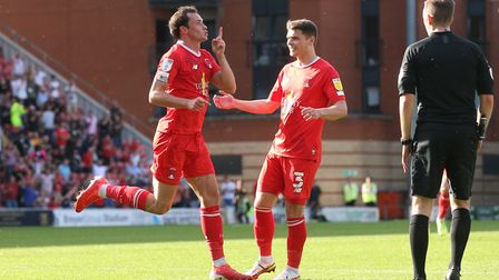 Theo Archibald of Leyton Orient scores the third goal for his team and celebrates during Leyton Orie