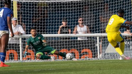 Michael Johnson saves Temi Babalola's penalty as St Albans City forced a draw at Concord Rangers in the FA Cup.