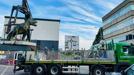 The GoGoDiscover T-Rex sculptures being picked up for their return to the warehouse