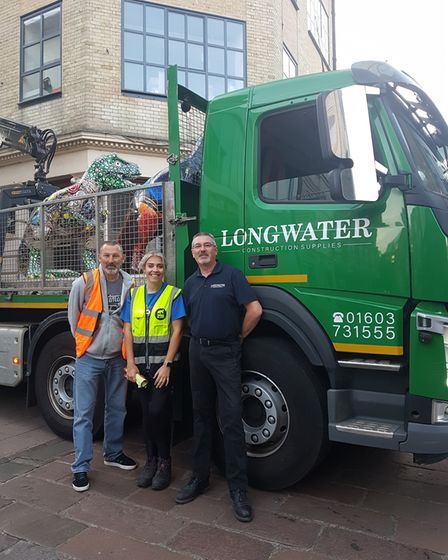 Eleanor Edge from Break with the team from Longwater who collected the T-Rex sculptures
