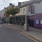 A man has been arrested after assaulting three police officers outside Popworld in Prince of Wales Road, Norwich.