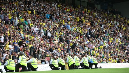 The home fans have seen enough and head for the exits early during the Premier League match at Carro