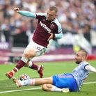 West Ham United's Jarrod Bowen (left) and Manchester United's Luke Shaw battle for the ball during t