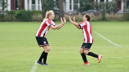 Emily Link and Maria Mendonca celebrate Clapton's second