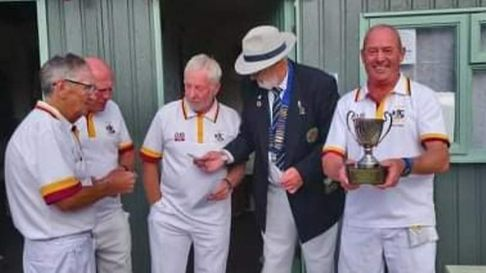 The Mid Devon League Cup is presented to Paignton playersBob Bushell, Keith Clarke, Jim Stewart and Peter Gerry.