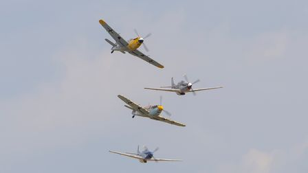 P-51 Mustangs andBuchons in flight at IWM Duxford at the 2021 Battle of Britain Air Show.