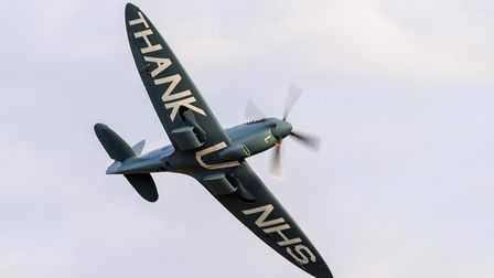 A solo display from the 'NHS Spitfire', painted with a message of thanks on the underside of its wings