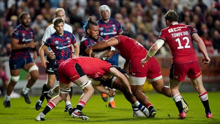 Bristol Bears' Nathan Hughes is tackled by Saracens' Billy Vunipola during the Gallagher Premiership