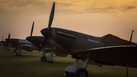 IWM Duxford's own Spitfire Mk 1a (front), and Hurricanes line-up ahead of the day's flying action.