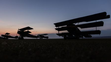 Biplanes and triplanes at sunrise, replicas of First World War aircraft flown by the Great War Display Team