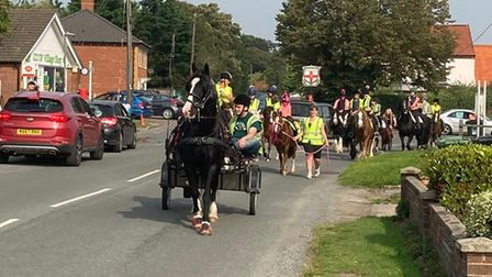 Horse riders and cart drivers taking part in aprocession at Briston which was part of a national campaign