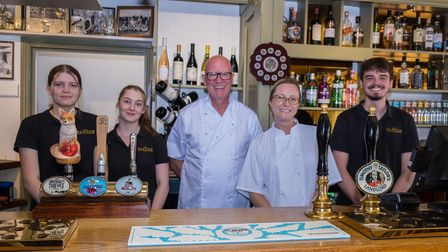 A row of five staff members at The Curious Goat, Saffron Walden