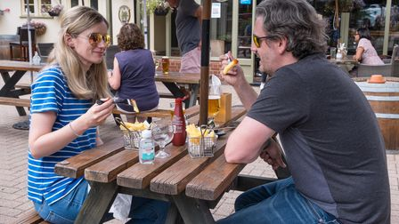 Two customers enjoying lunch at The Plough pub, Great Chesterford