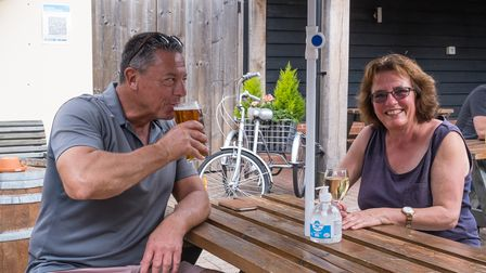 Two customers enjoying a drink at The Plough pub, Great Chesterford