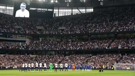 Players give a minute's applause in honour of the late Jimmy Greaves before the Premier League match