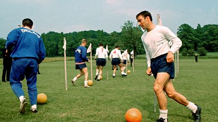 File photo dated 15-06-1966 of England's Jimmy Greaves dribbles through a set of poles along with se