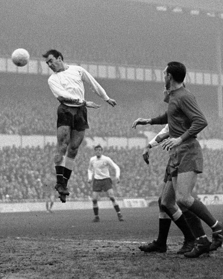 File photo dated 27-12-1966 of Spur's Jimmy Greaves (left) leaps for a ball and scores in the match