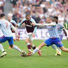 West Ham United's Jarrod Bowen (centre) battles for the ball with Manchester United's Cristiano Rona